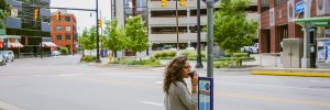 Passenger waiting for the bus in downtown Grand Rapids.